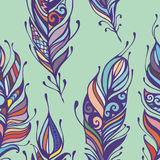 Beautiful hand drawn feathers boho and hippie style seamless pattern background.  Royalty Free Stock Photos