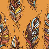Beautiful hand drawn feathers boho and hippie style seamless pattern background.  Royalty Free Stock Image