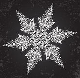 Beautiful hand drawn ornamental doodle snowflake. Royalty Free Stock Image