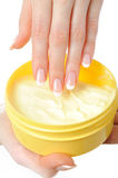 Beautiful hand with french manicure and cream Royalty Free Stock Photos