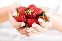 Beautiful hand with fresh strawberry Royalty Free Stock Photo
