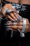 Beautiful hand of the girl with dark skin graft of acrylic nails with nail unusual fotmoy Stock Images