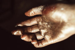 Beautiful hand in golden paint on black background Royalty Free Stock Photo