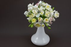 Hand made polymer clay bouquet in a white vase on a dark backgro. Beautiful hand made flowers of polymer clay Stock Photography