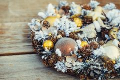 Beautiful hand made golden Christmas wreath decorated with pine cones, ornamentals, spruce branches, balls, stars, decorative deer royalty free stock photos