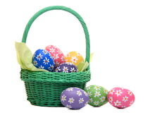 Beautiful hand painted easter eggs in green basket Stock Photo