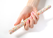 Beautiful hand with perfect manicure, sweet candy Stock Images