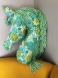 Beautiful hand sewn unicorn pillow royalty free stock photo