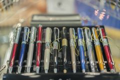 Beautiful handles in the case. Multicolored gift pens. blurry.  royalty free stock photos