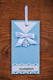 Beautiful handmade blue vertical invitation envelope on old wood Royalty Free Stock Image