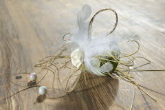 Beautiful handmade decjration is made of ribbons, feathers, beads Stock Image