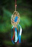 Beautiful handmade dreamcatcher. In the forest outdoor Stock Photo