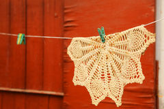 Beautiful handmade knitted serviette hand on the rope with cloth Stock Photography