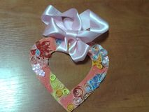 Beautiful handmade origami heart, fayette, pink bow, royalty free stock photography