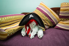 Beautiful handmade towel figure decorated with pirate  hat for Halloween party Royalty Free Stock Photos