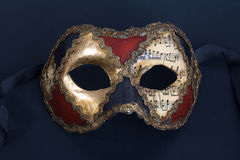 Beautiful handmade venetian mask on dark blue back Royalty Free Stock Images