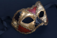 Beautiful handmade venetian mask on dark blue back Royalty Free Stock Photo