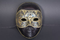 Beautiful handmade venetian mask on dark blue back Royalty Free Stock Image