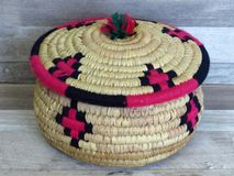 Beautiful Handmade Woven Bamboo / Cane Basket / box with Colourful Woollen Elements. stock images