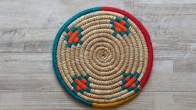 Northern Iran handicraft. Beautiful Handmade Woven Bamboo / Cane Tray. A Single Beautiful Handmade Woven Bamboo / Cane Tray with Colourful Woollen Elements in stock photo