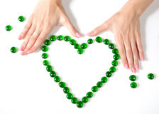 Beautiful hands building a heart sighn Stock Images