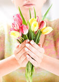 Beautiful hands with bunch of tulips Stock Image