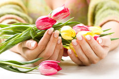 Beautiful hands with bunch of tulips Stock Photo