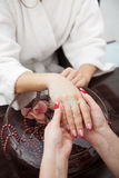Beautiful hands close-up - spa prodedure. This image has attached release Stock Photo