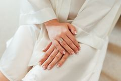 Beautiful hands of a girl in lace negligee. Beautiful hands of a girl in a lace negligee Royalty Free Stock Image