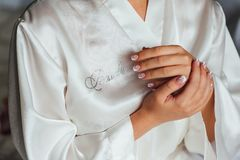 Beautiful hands of a girl in lace negligee. Beautiful hands of a girl in a lace negligee Stock Photo