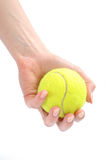 Beautiful hands holding tennis ball Royalty Free Stock Image