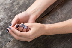 Beautiful hands with the miniature painted in a Royalty Free Stock Photography