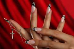 Beautiful hands and nails. On a red background Royalty Free Stock Photos