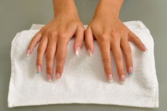 Beautiful hands with nails. On white towel Stock Photo