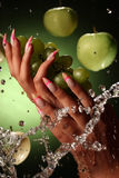 Beautiful hands and nails on green background. Beautiful hands and nails of a young girl Royalty Free Stock Image