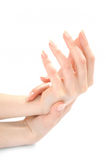 Beautiful Hands with perfect beige manicure Stock Photography