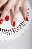 Beautiful hands with perfect manicure and cards Royalty Free Stock Image