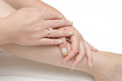Beautiful hands showing nails. With figure Royalty Free Stock Photography