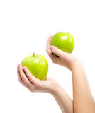 In beautiful hands a two green apple , Isolated on white background stock photo