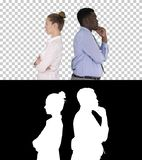 Beautiful and handsome guy standing back to back changing poses, Alpha Channel stock photos