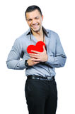 Handsome young macho man holding love heart. Beautiful handsome young macho man holding love heart and smiling to you Royalty Free Stock Photography