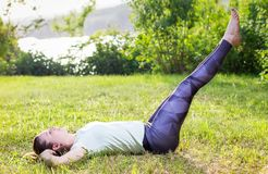 Young woman exercising outdoors in nature Stock Photography