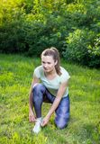 Young woman exercising outdoors in nature. Beautiful handsome young woman exercising outdoors in nature, healthy lifestyle Royalty Free Stock Photography