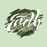 Beautiful handwritten text, calligraphy, lettering Happy Earth Day on April 22 on a textured background. Vector illustration for g. Reeting card, poster, logo Stock Photo