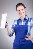 Beautiful handywoman with trowel Royalty Free Stock Photography