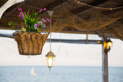 Beautiful hanging basket with artificial flowers Stock Photo