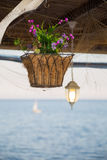 Beautiful hanging basket with artificial flowers Royalty Free Stock Photos