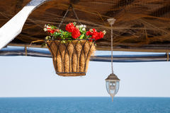 Beautiful hanging basket with artificial flowers Stock Photography