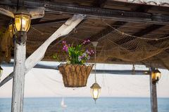 Beautiful hanging basket with artificial flowers Royalty Free Stock Photography