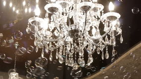 Beautiful hanging crystal chandelier on ceiling stock video footage